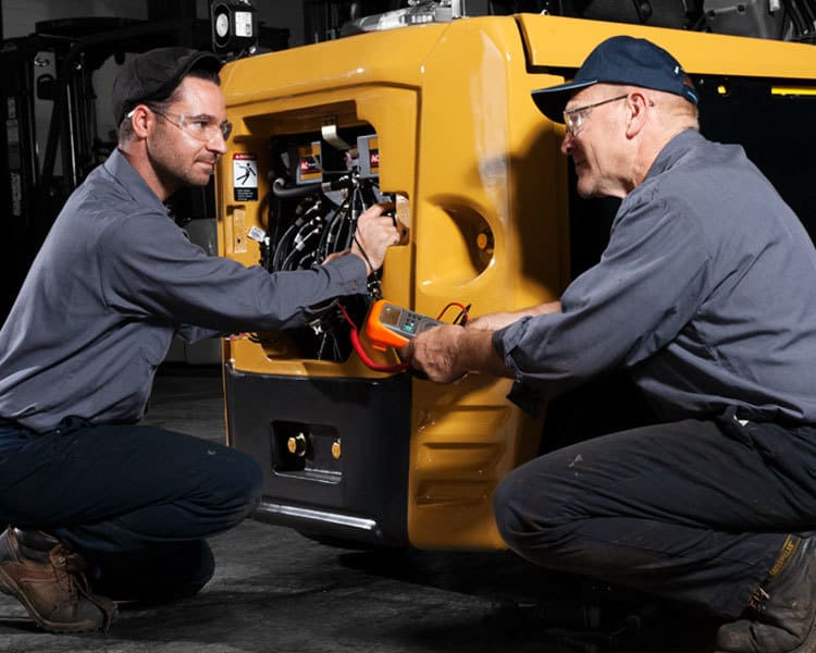 Service Technicians Repairing a Vehicle